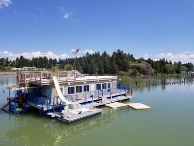 Floating House On Flathead Lake With Waterside Kayaks Rooftop Deck And More