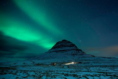 Northern lights over Mt Kirkjufell (Church mountain)