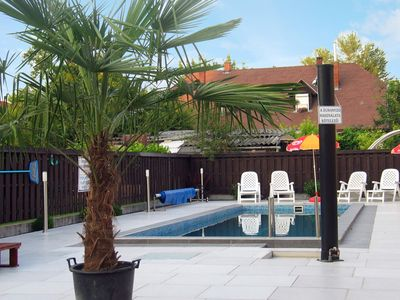 Holiday apartment with pool, sauna and children's swing