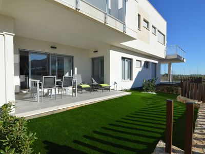 Photo for Modern house with garden and large shared swimming pool in Vistabella Golf