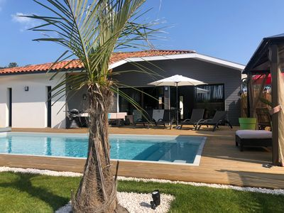 Photo for Modern house with heated pool next to the beaches