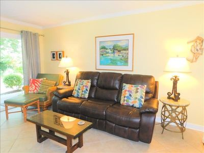 Photo for E9 Ocean Walk is a downstairs two bedroom, two bath condo that is very close to front pool.  Unit has an open kitchen floor plan and has been completely redecorated recently.  Bedding is a king and a queen size bed, unit has tile floors throughout.
