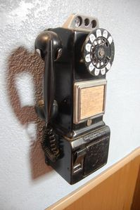 Whisper sweet nothings into this antique payphone for good luck.