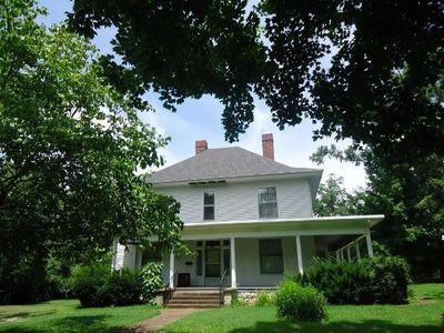 Photo for This beautiful colonial farmhouse is one mile from historic Fayetteville.
