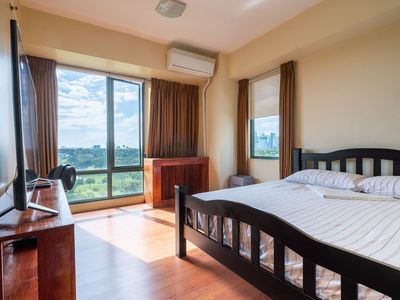 Photo for Luxury Corner Unit - Golf Course View - Pool, Gym, High Ceilings, Big Windows