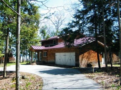 View of cottage from driveway, facing Grand Traverse Bay