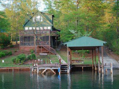 View of the house, boat house, dock and ramp from the lake.