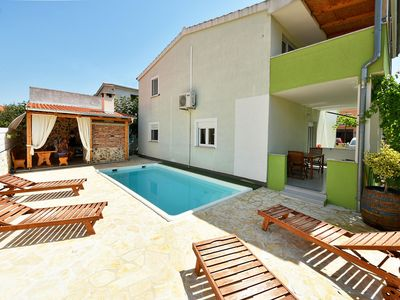 Photo for This 4-bedroom villa for up to 8 guests is located in Zadar and has a private swimming pool, air-con