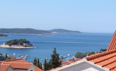 Photo for Two bedroom apartment with terrace and sea view Hvar (A-4047-b)