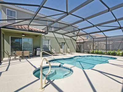 Photo for Grill/Private pool and hot tub/Huge Deck/Great resort/10 mins Disney/Back yard/