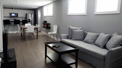 Open floor plan; private side entrance near kitchen leads to off-street parking