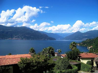 Photo for 180 ° panoramic lake view - 3 bedrooms Apartment Lago Maggiore Balcony Pool Beach Tennis Wi-Fi