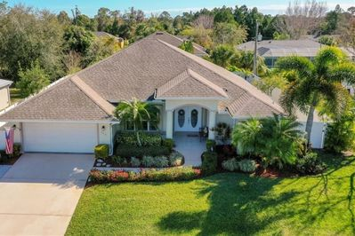 """This exquisite home """"Coastal Charmer"""" has been professionally  landscaped!"""