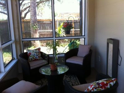 Relax on the front screened porch