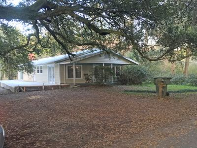 Photo for A comfortable home in a quiet neighborhood graced with Spanish Moss draped oaks.