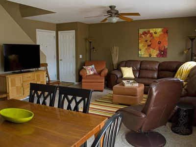 The living and dining area includes a large television.