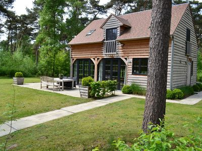 Photo for Beautiful wooden lodge with pleasant garden in the forests of Oisterwijk