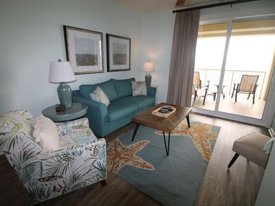 Photo for BEACH CHAIR SERVICE INCLUDED! Gorgeous 2bed+bunk,2 bath beachfront condo!