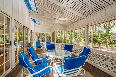 Large screen porch runs the length of the house.