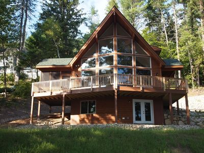 Photo for This impressive Adirondack has a commanding deck and screened-in porch. All new furnishings inside.