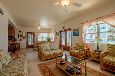 Beautiful expansive living room with tasteful island colors and local artwork