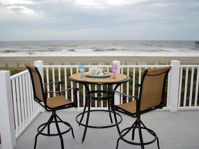 Photo for Come to paradise at Holden Beach!  Sit on the oceanfront deck, watch the sunset and listen to waves crash along the shore. Water's Edge 435A