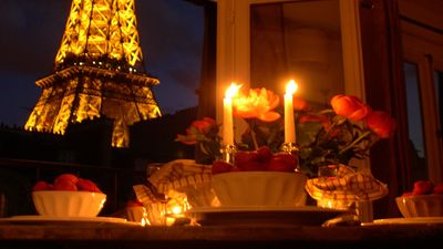 Enjoy a candle-lit dinner with awesome Eiffel Tower views!