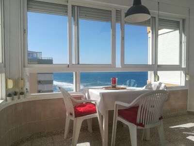 Photo for Apartment on the beachfront with sea views. Torrox Costa
