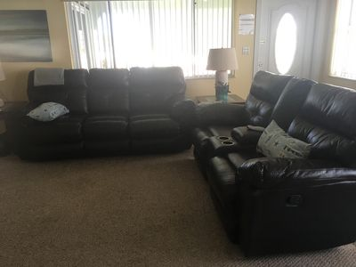 Living room with double recliners in sofa's