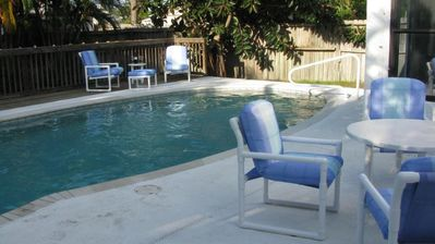 Photo for Luxury home, heated pool, fireplace, walk to the beach
