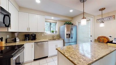 Newly Renovated Kitchen with Quartz Countertops