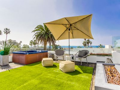 Sapphire Sunset.  Beautiful high end home with spectacular rooftop views.