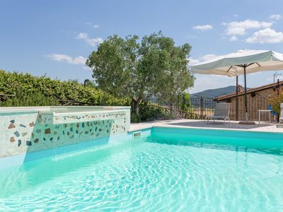 Photo for Cosy apartment in villa for three guests with pool, WIFI, A/C, TV and parking