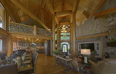 This open space provides an inviting place to congregate before meals. #fireplace