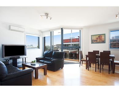 Photo for Bright corner apartment only a stroll from the CBD