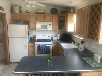 Kitchen has Newer Appliances Including Stove/Oven, Microwave, Dishwasher, etc.