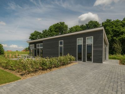 Photo for Modern chalet at the forest edge and a stone's throw away from the Oosterschelde