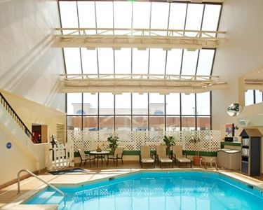 Relax by the indoor pool pool and get some sun