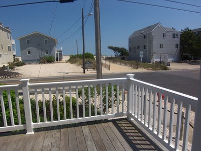 1st floor deck with view of beach enterance… steps away