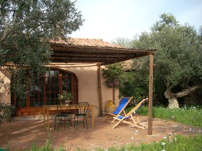 Photo for Charming farmhouse with stunning views over the Tuscan sea from the big garden