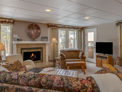 Enjoy the spacious living room with a gas fireplace and flat-screen T.V.
