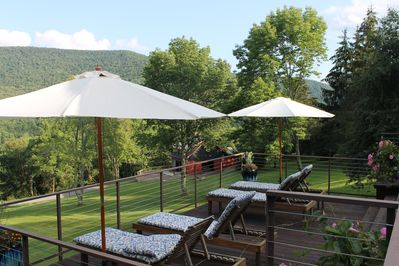 View of barn from front two-tiered deck. Relax & enjoy the mountain views.