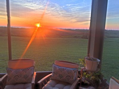 View of the sunrise from our screened patio