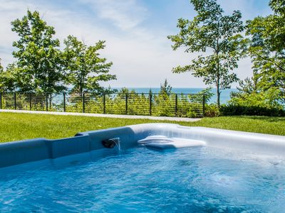 Photo for Newly built modern lakefront pool house, private beach, tram, amazing views