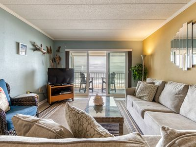 Photo for Cozy waterfront condo - mere steps to the beach and restaurants!