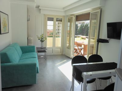 Photo for Stylish, central, top floor flat, wide terrace, calm, town & sea view