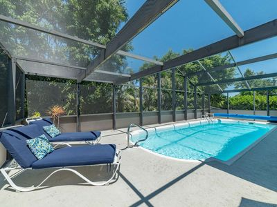Photo for 2 Blocks from Beach! Dog Friendly - Screened in Lanai w/ Heated Pool - Beach Gear Provided - WiFi