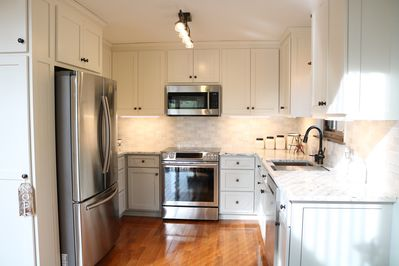 Remodeled kitchen with granite countertops and stainless steel appliances.