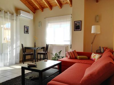 Photo for Topfloor apartment - 30m2 terrace, partial sea view, 500m from the beach, WiFi