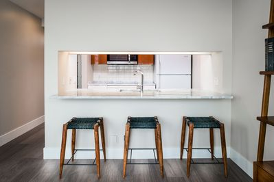 Island kitchen with seating for three